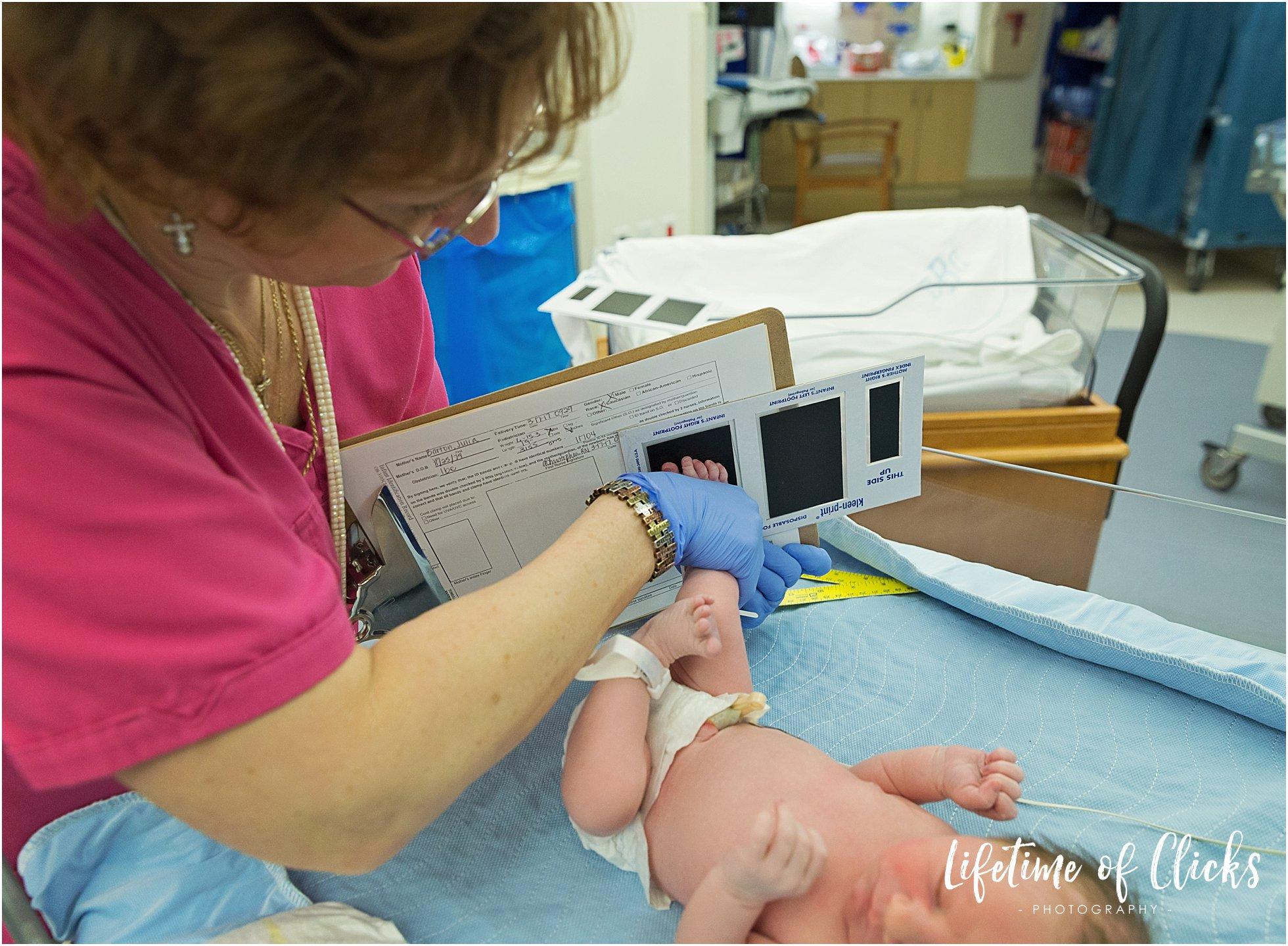 Nurse examines baby boy