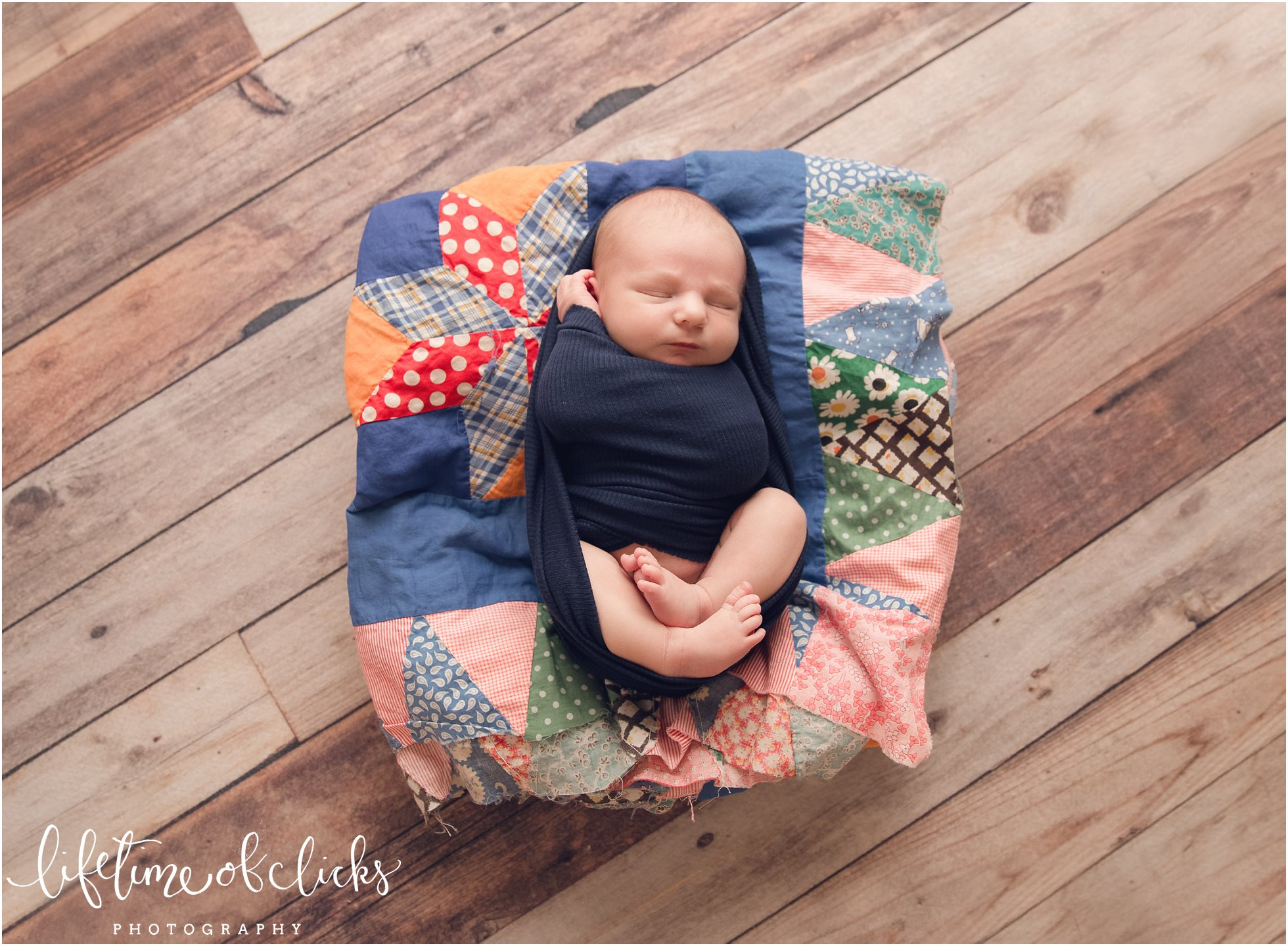 Newborn on colorful quilts | Photo by Lifetime of Clicks Photography