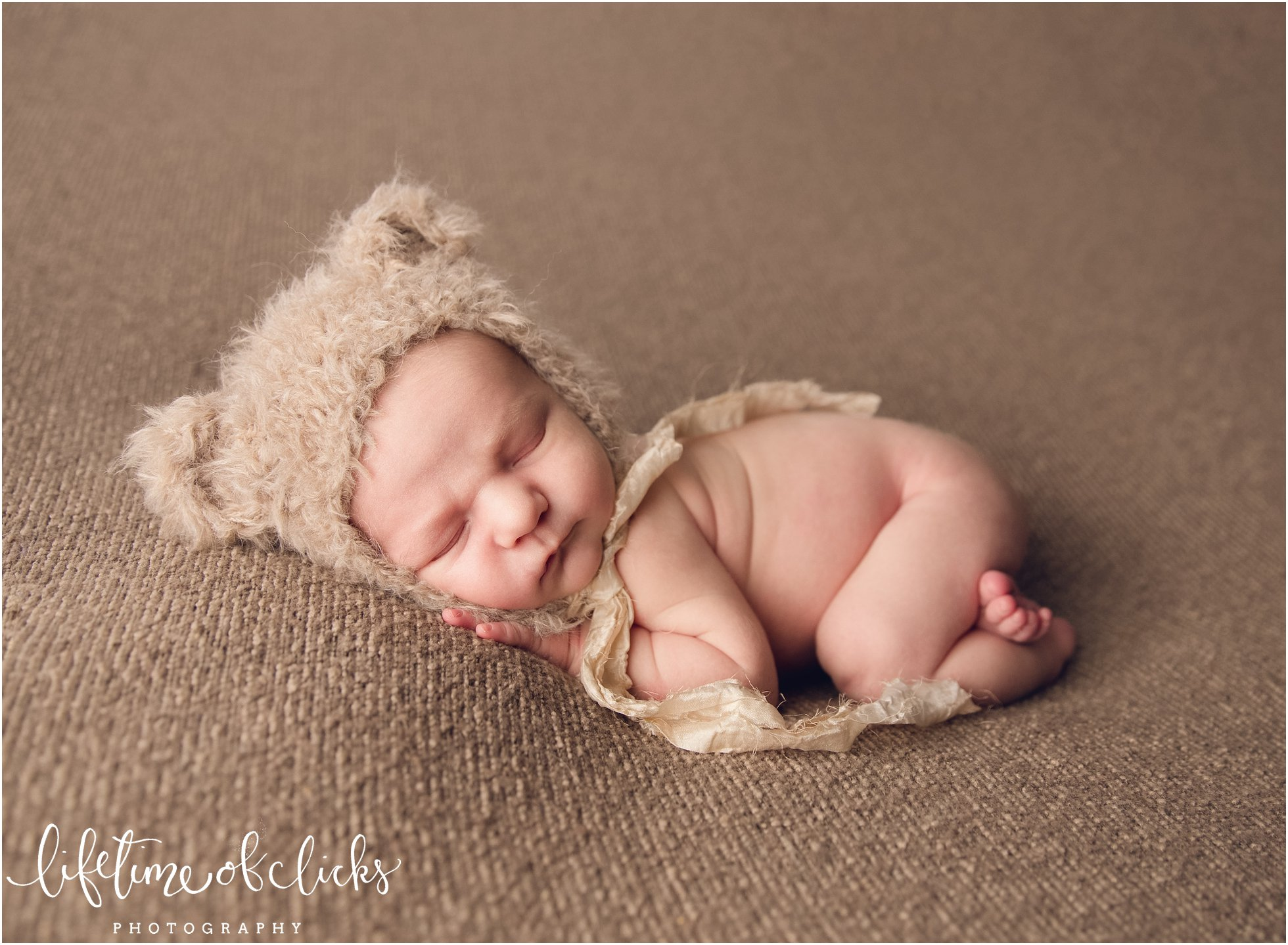Newborn in bear hat | Photo by Lifetime of Clicks Photography