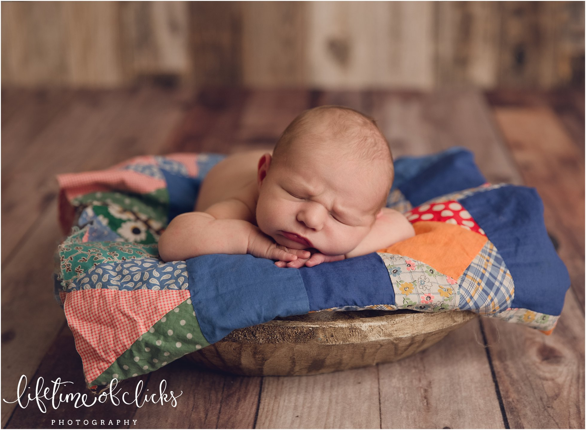 Newborn forward facing in prop photo | Photo by Lifetime of Clicks Photography
