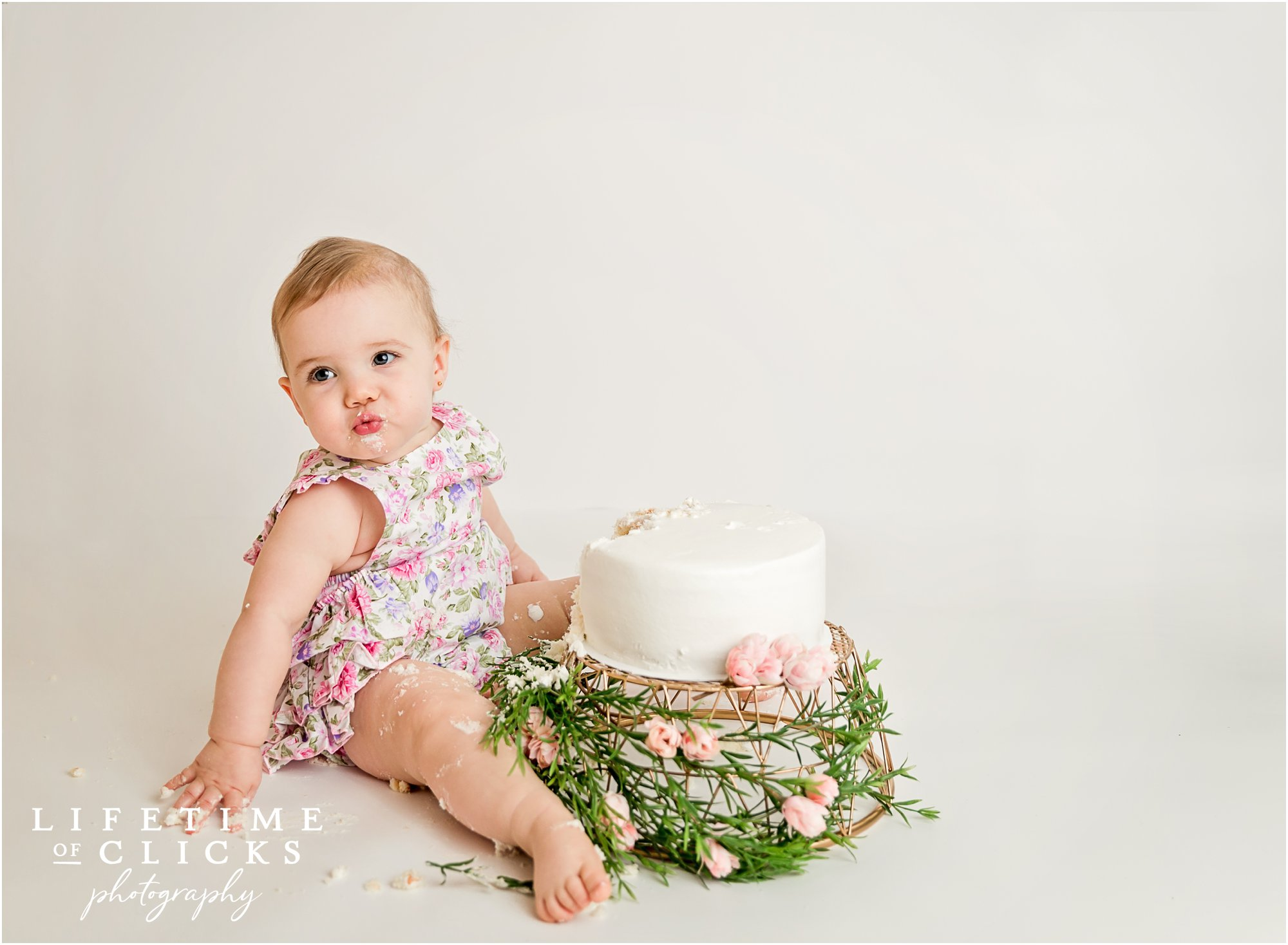baby girl after eating birthday cake