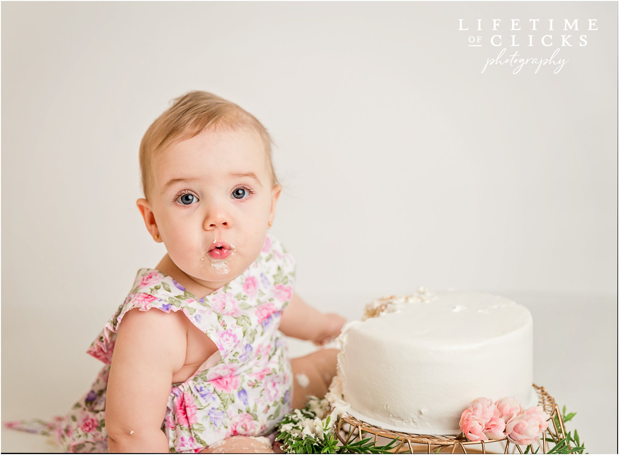 blue eyed girl eating birthday cake