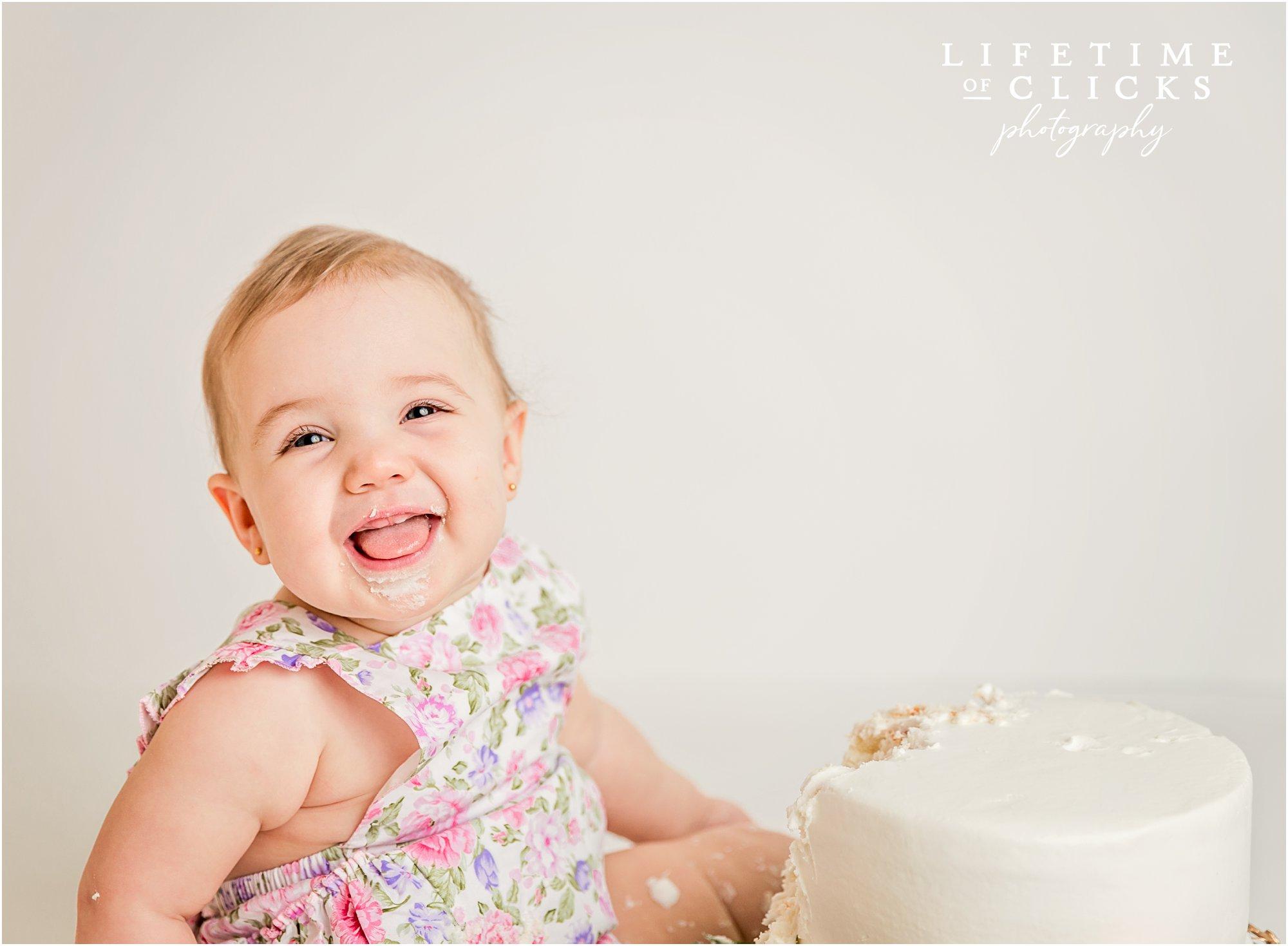 laughing girl eating birthday cake
