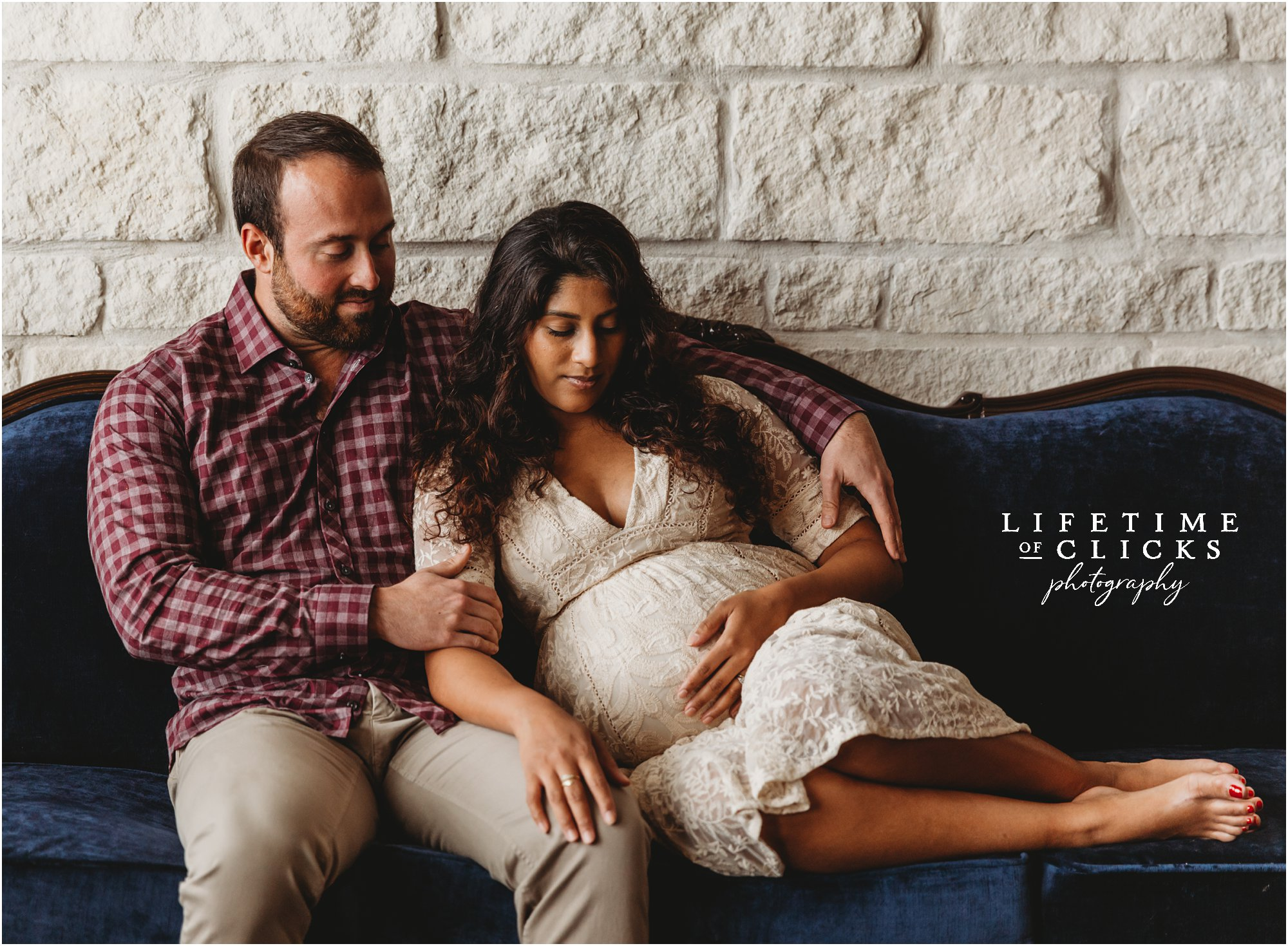 Intimate maternity portrait of husband and wife