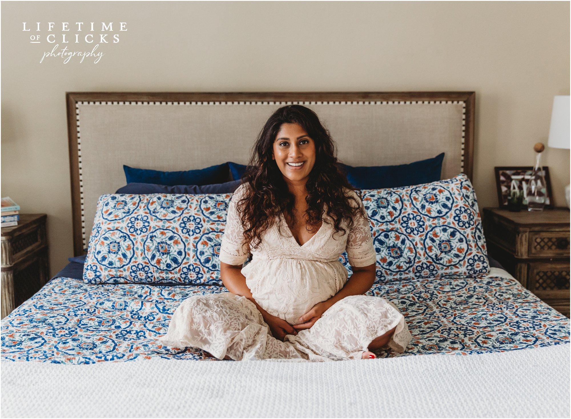 lifestyle maternity photo in couple's bedroom