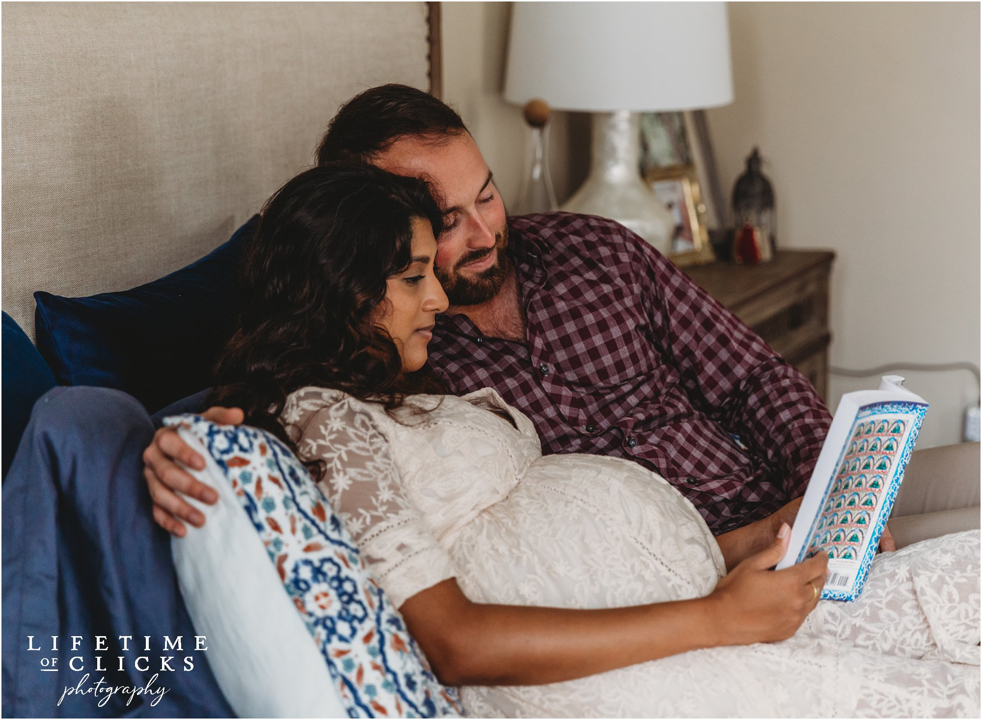 cute lifestyle maternity photo in Katy TX with baby books