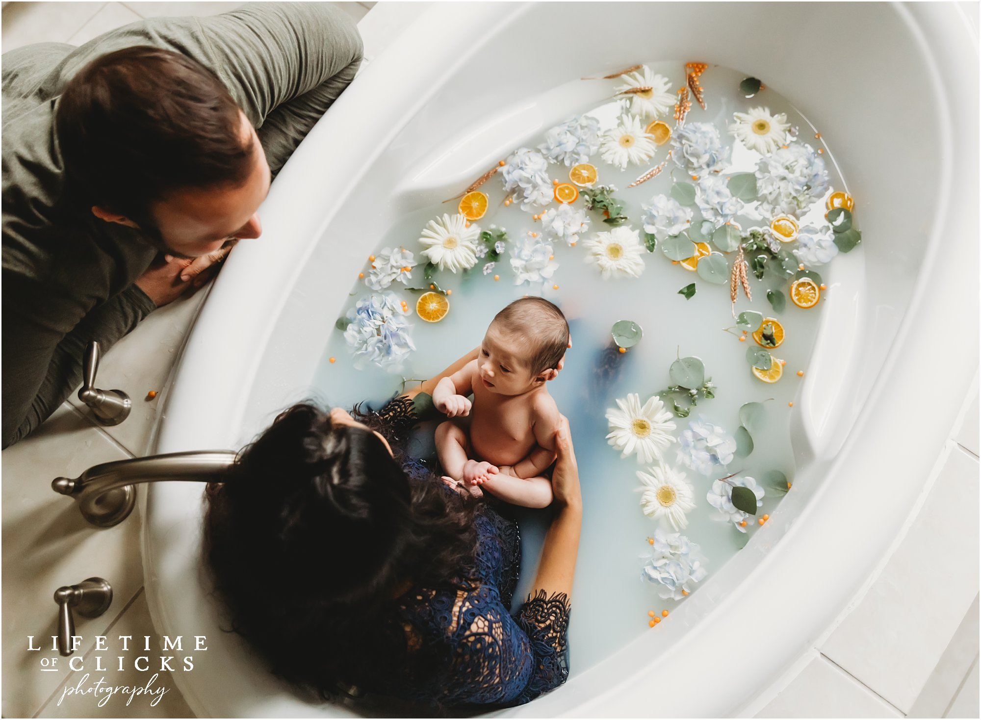 In-home newborn lifestyle session with milk bath