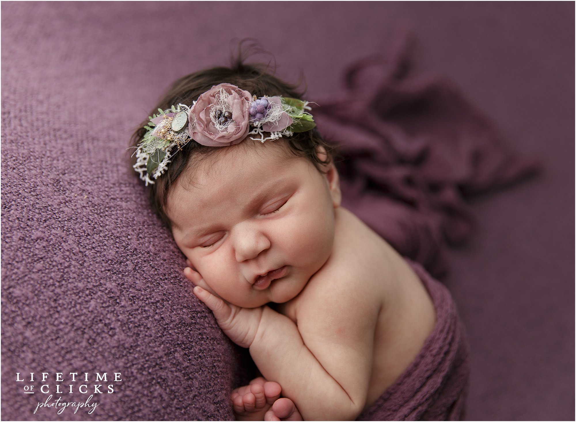 newborn girl with flowered headband