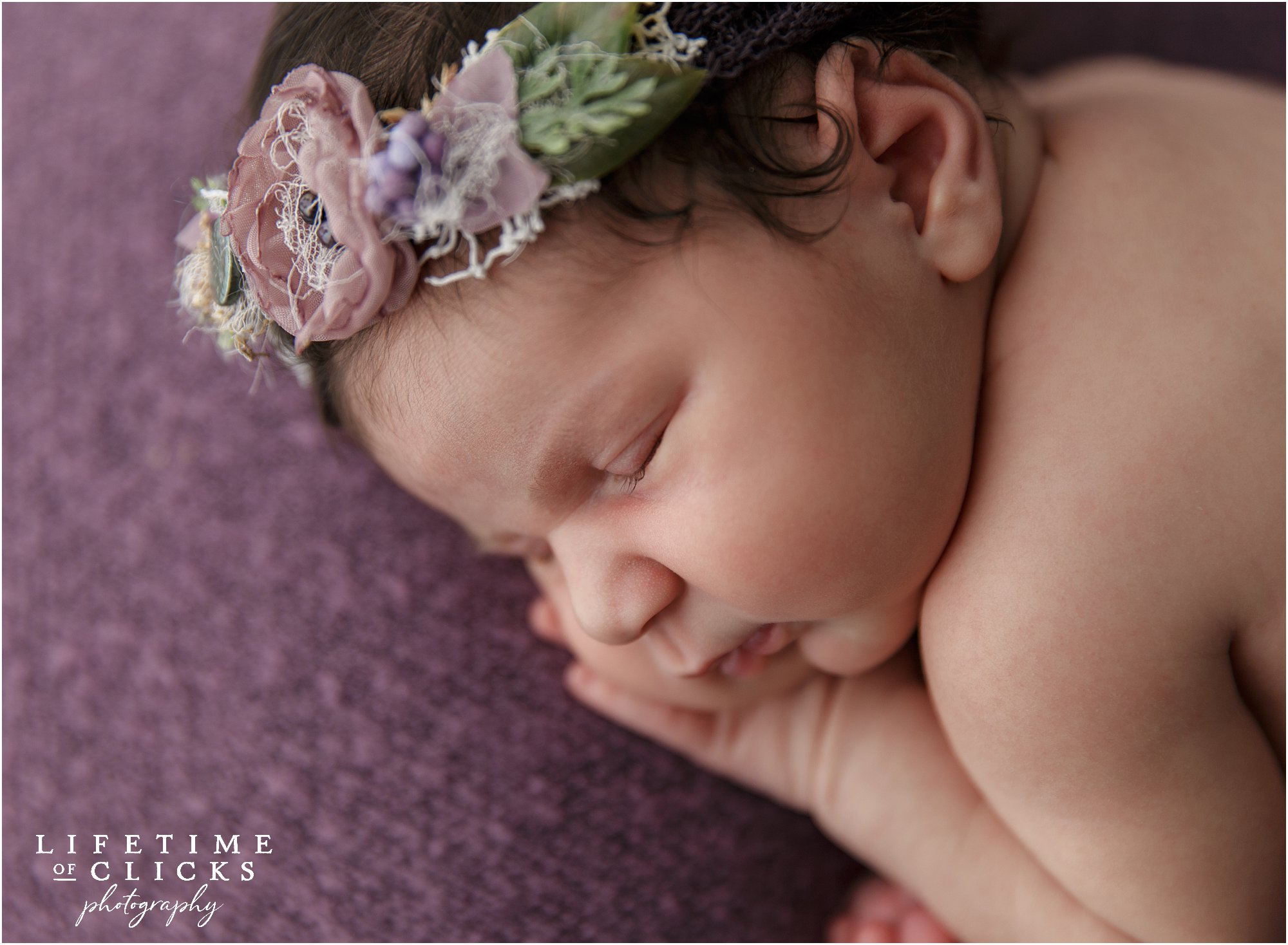 newborn girl with purple headband