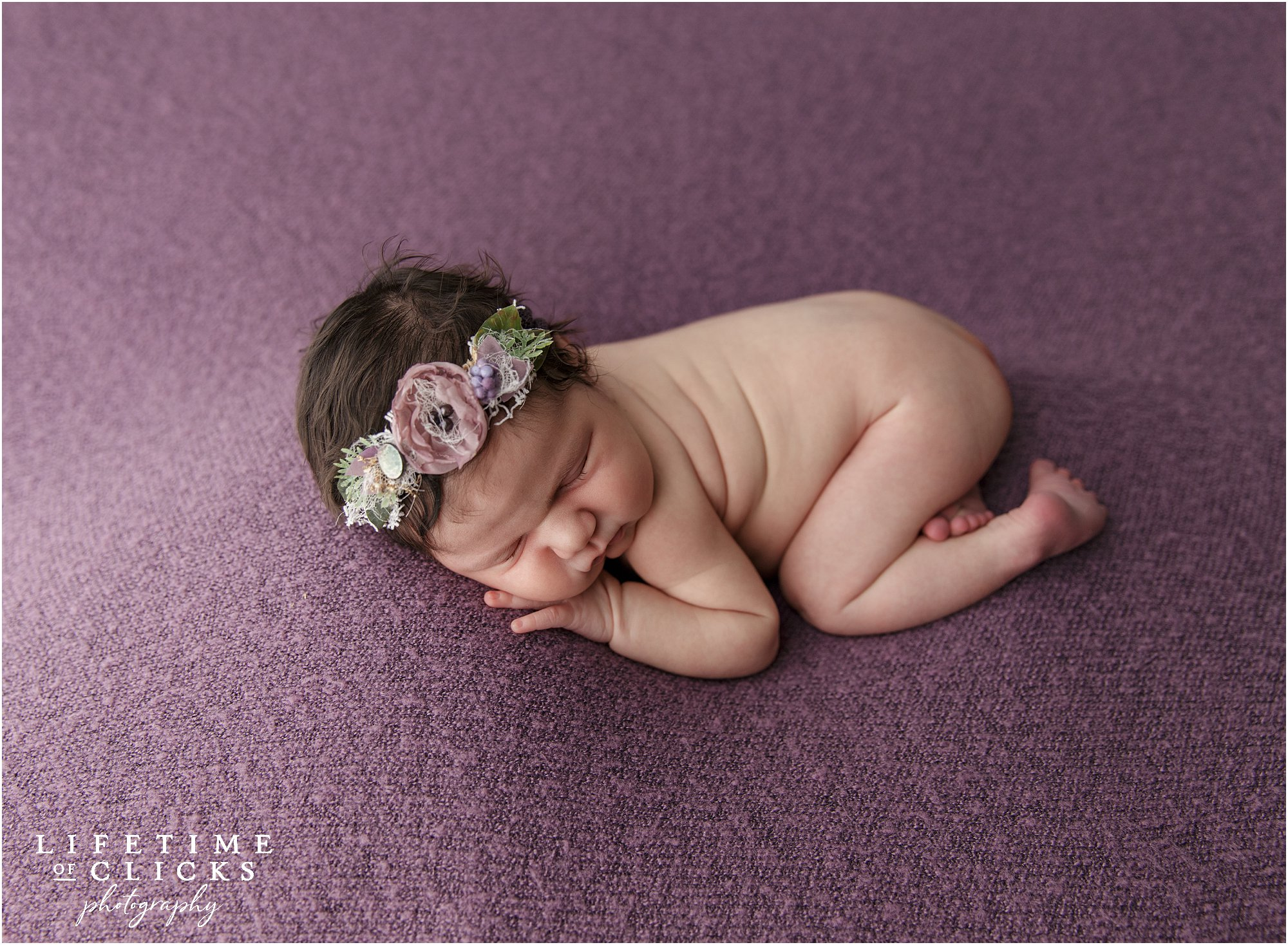 sleepy newborn girl with rustic headband