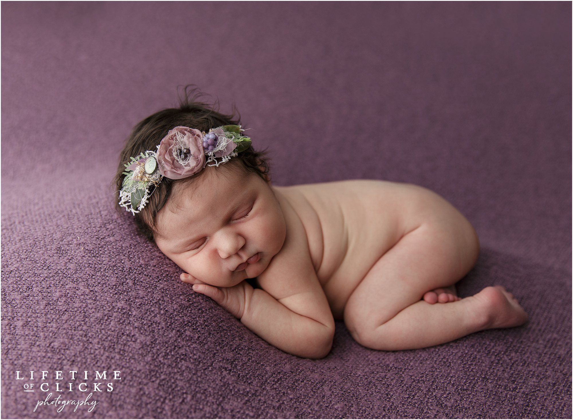 newborn girl with lavender flowered headband