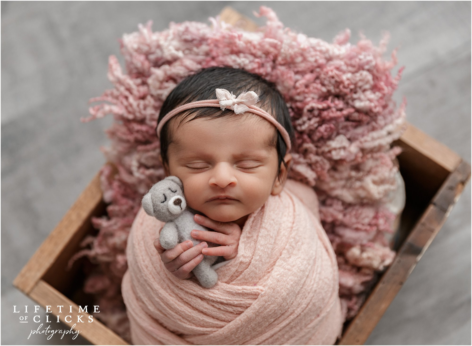 newborn girl wearing pink headband