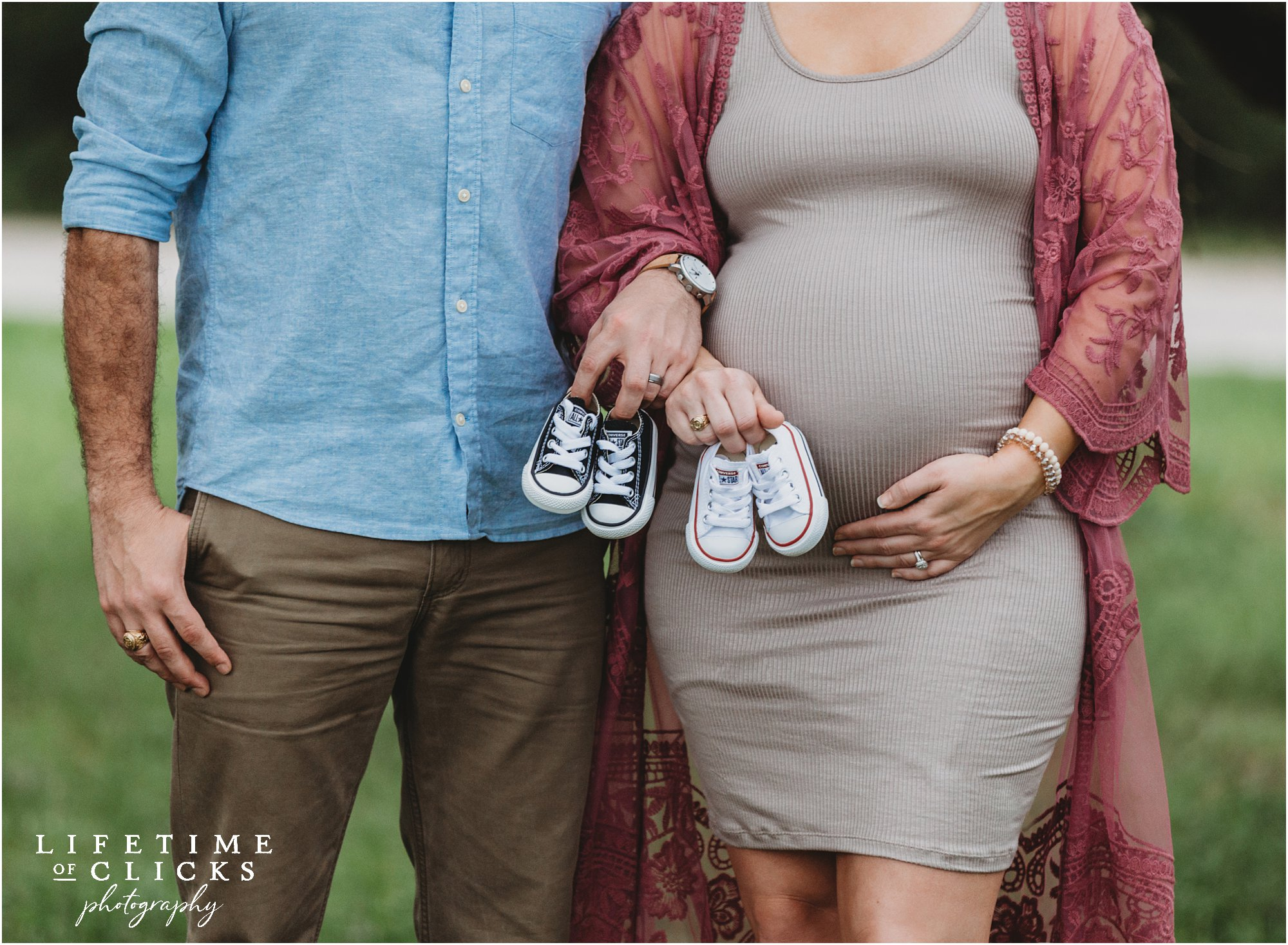 maternity photo with tiny sneakers