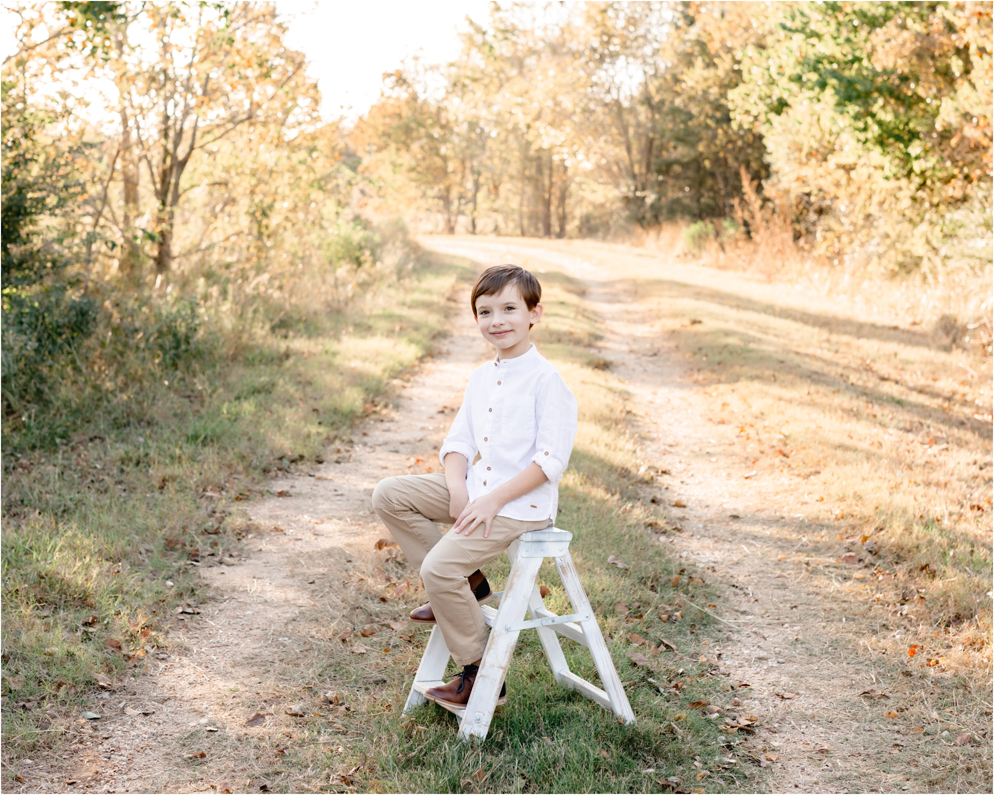 Boy posing on ladder during sunset park family session in Katy, TX. Photo by Lifetime of Clicks Photography.