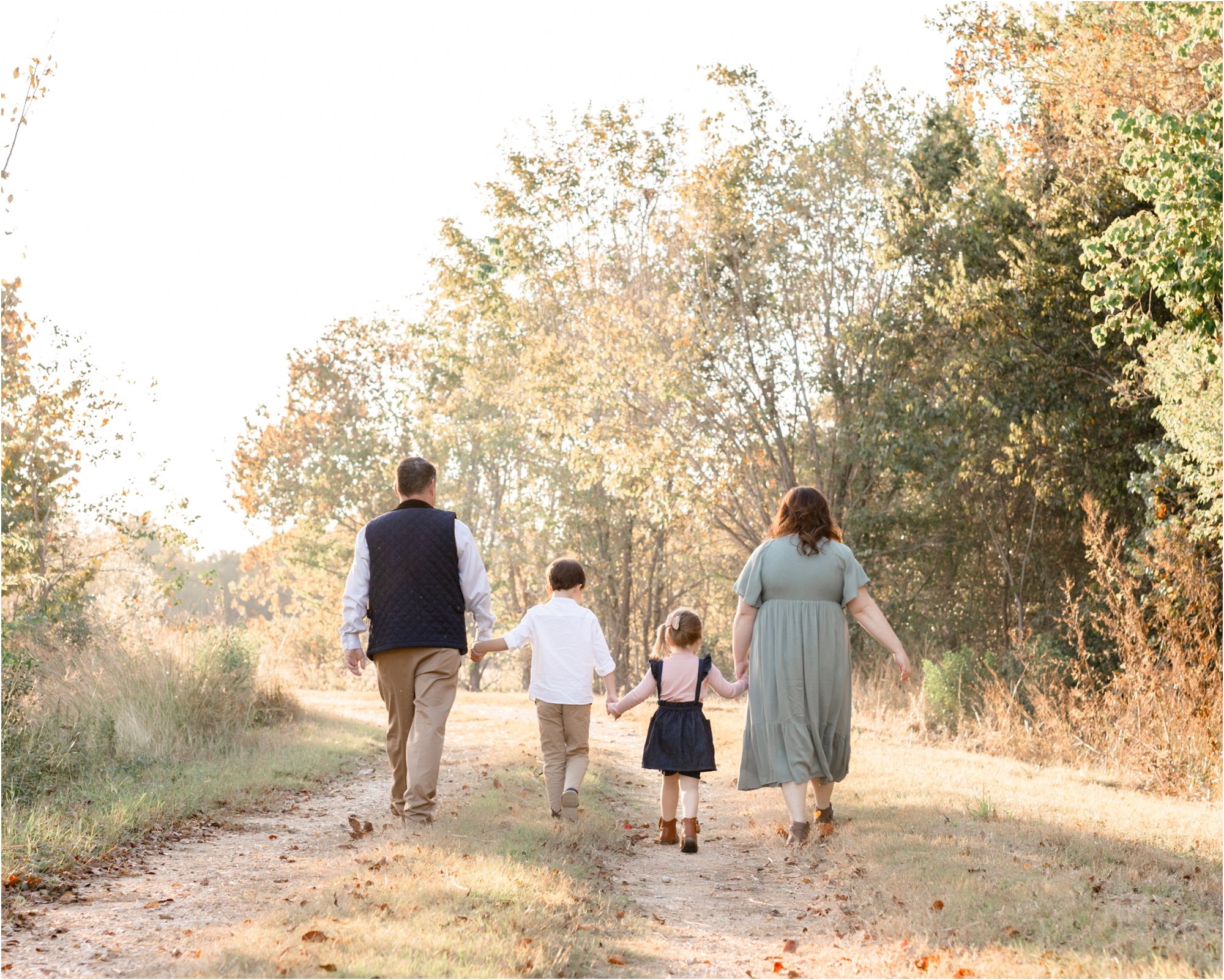 Family walking away during beautiful sunset park session. Photo by Lifetime of Clicks Photography.