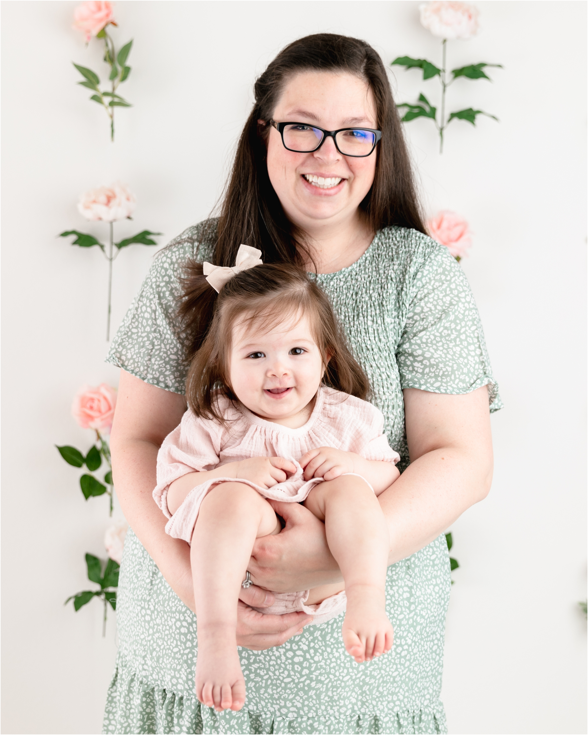 Mom and daughter wearing dresses from the client wardrobe during milestone session in studio. Photo by Houston TX photographer, Lifetime of Clicks Photography.