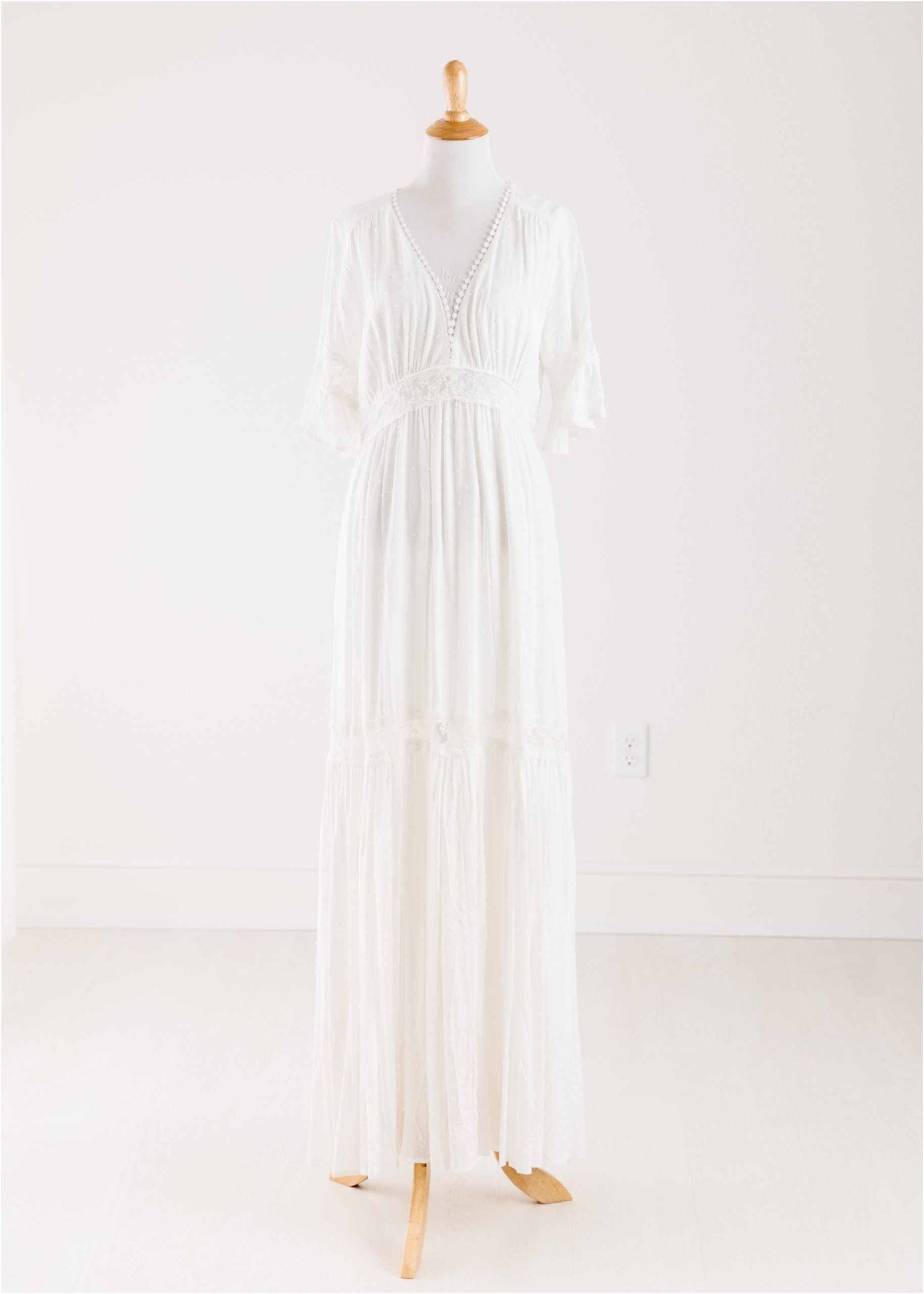 White maxi dress provided by the Client Wardrobe of Houston TX photographer, Lifetime of Clicks Photography.