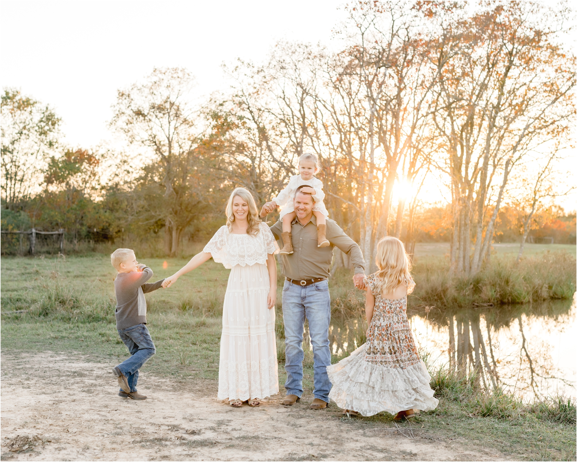 Parents twirling kids in sunset near pond on their property by Katy family photographer, Lifetime of Clicks Photography.