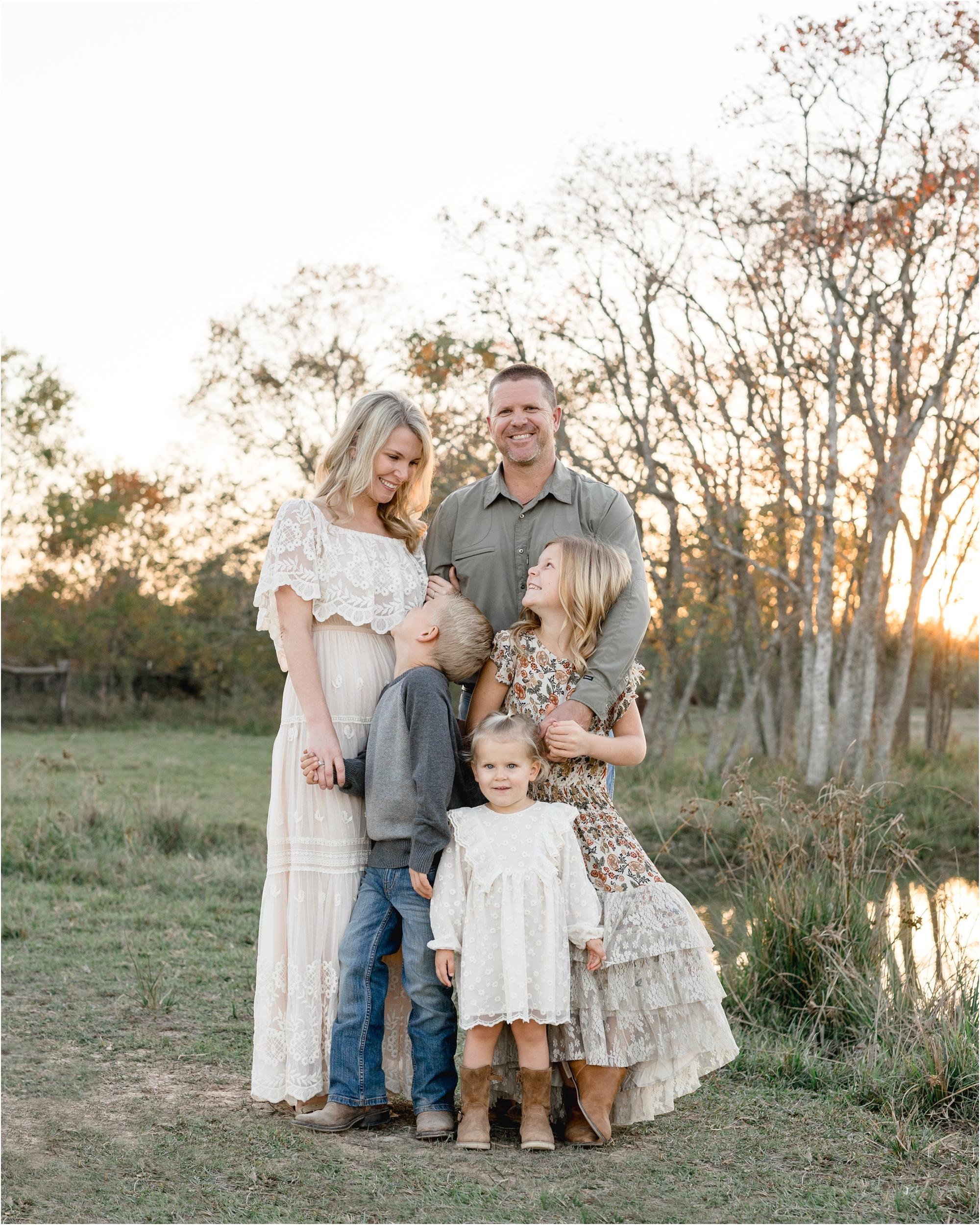 Sweet image of family of five with kids looking at Mom during sunset family session by Katy family photographer, Lifetime of Clicks Photography.