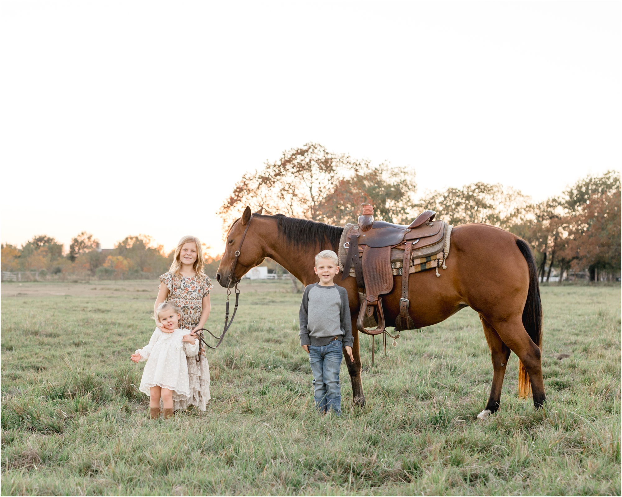 Portrait of three children with horse on private property by Katy family photographer, Lifetime of Clicks Photography.