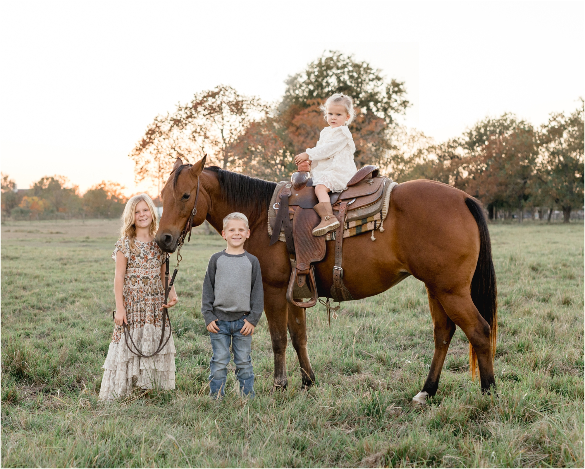 Portrait of siblings with their horse during sunset session by Katy family photographer, Lifetime of Clicks Photography.