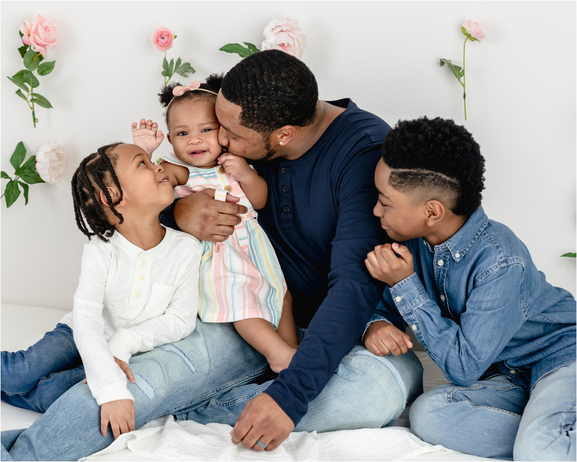 Dad cuddling with kids during photoshoot with Kelly from Lifetime of Clicks Photography.