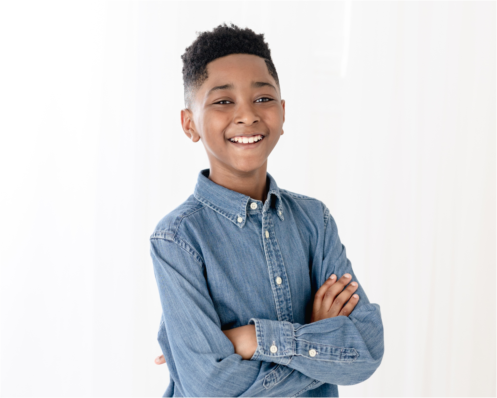 Boy smiling at camera during studio session with Houston photographer, Kelly of Lifetime of Clicks Photography.