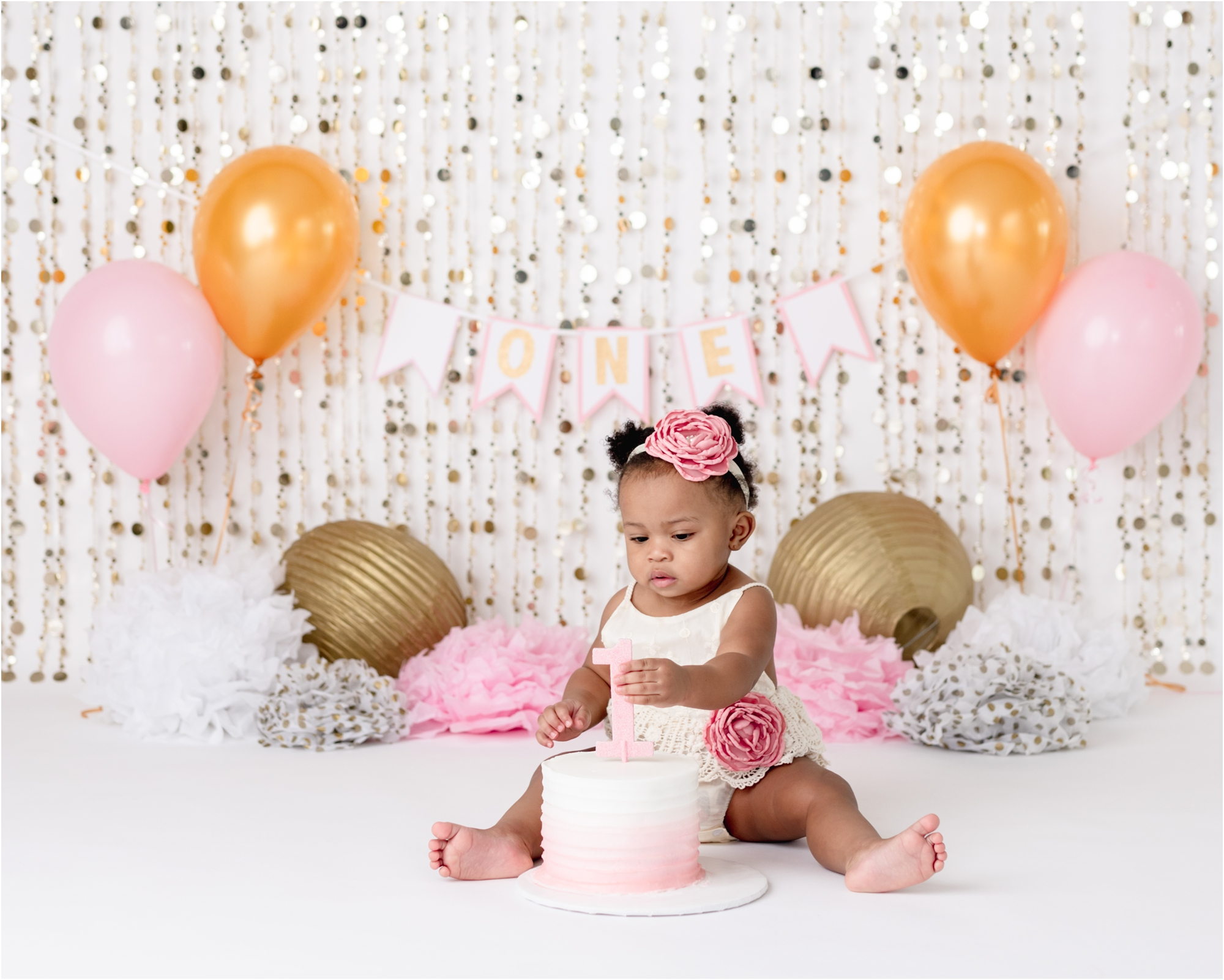 First birthday cake smash photoshoot in Houston studio with family portraits by Lifetime of Clicks Photography.