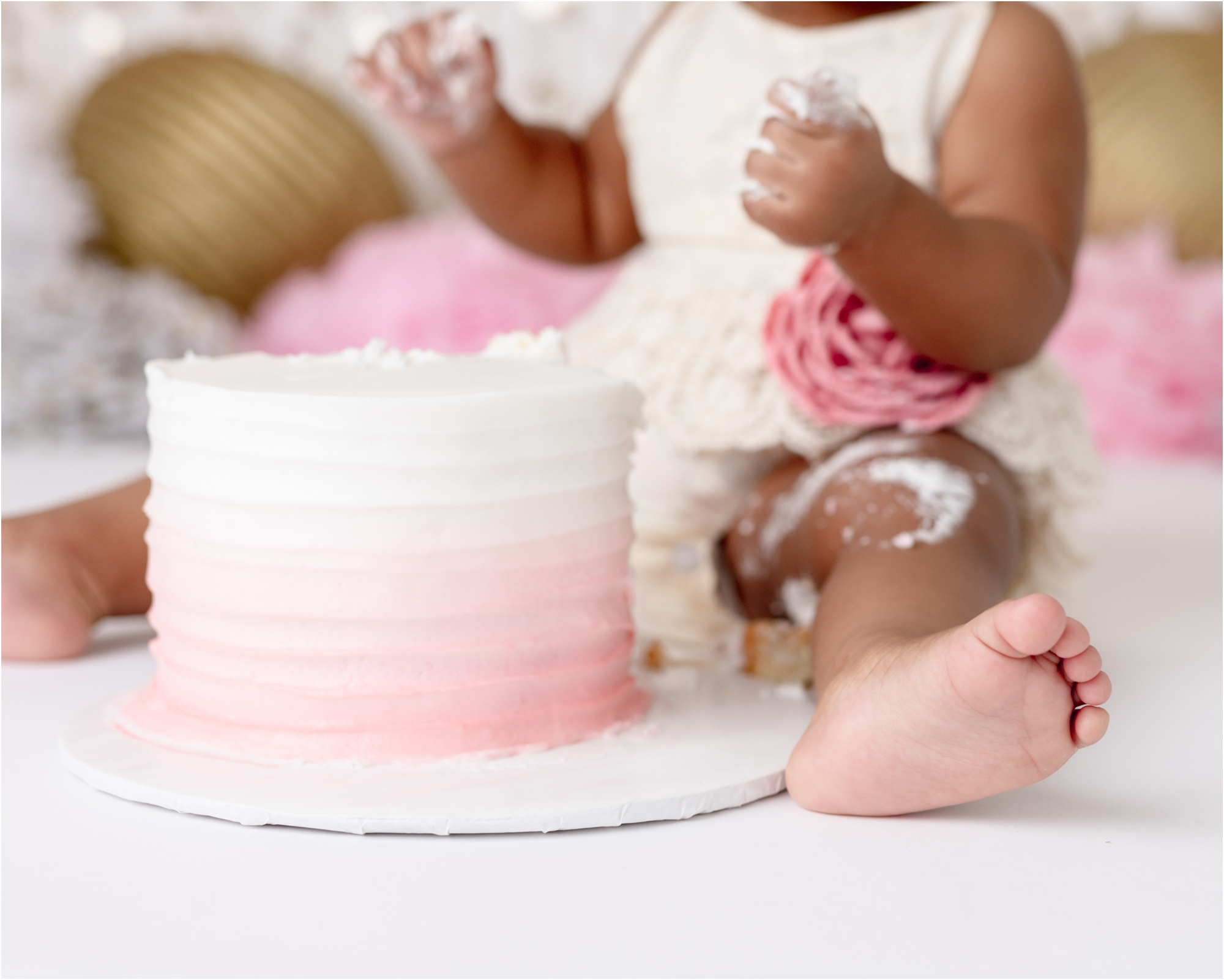 Pink ombre cake from pink and gold cake smash session. Photo by Lifetime of Clicks Photography.