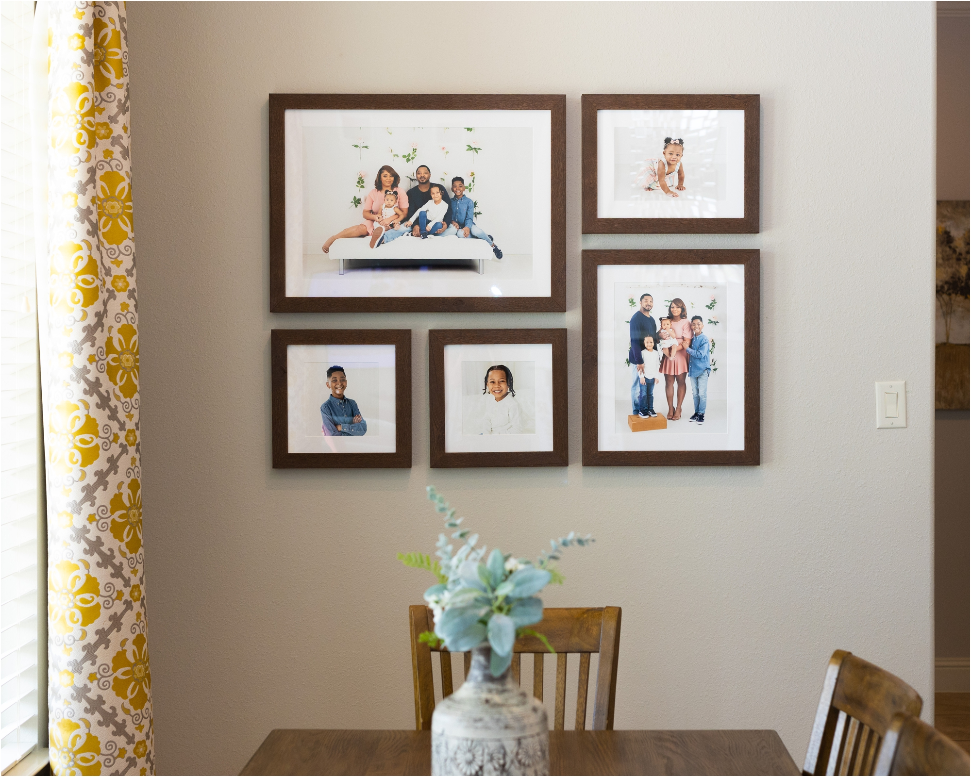 Custom designed gallery wall design by Houston family photographer, Kelly of Lifetime of Clicks Photography.