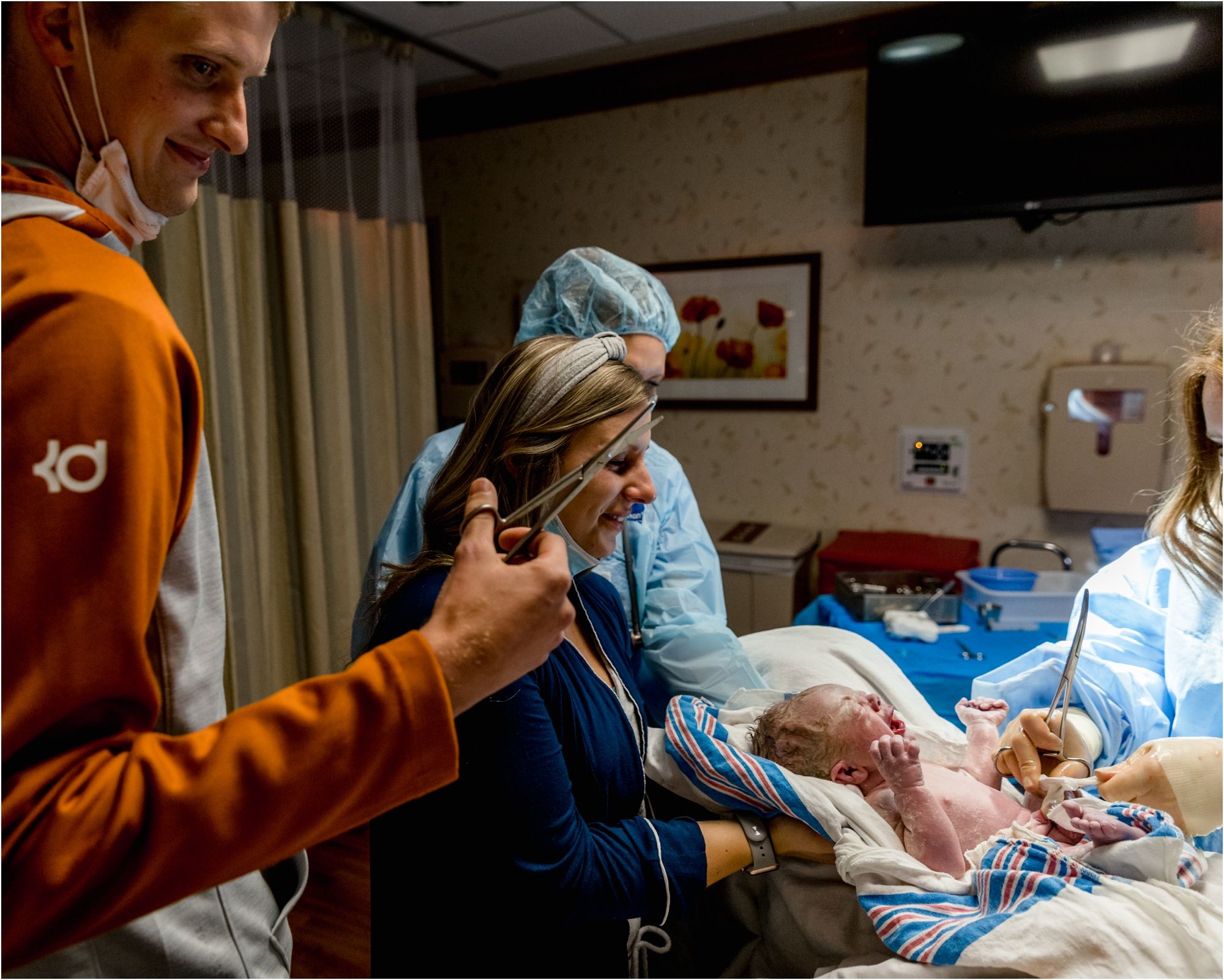 Intended parents waiting to cut umbilical cord during birth session. Photo by Lifetime of Clicks Photography.
