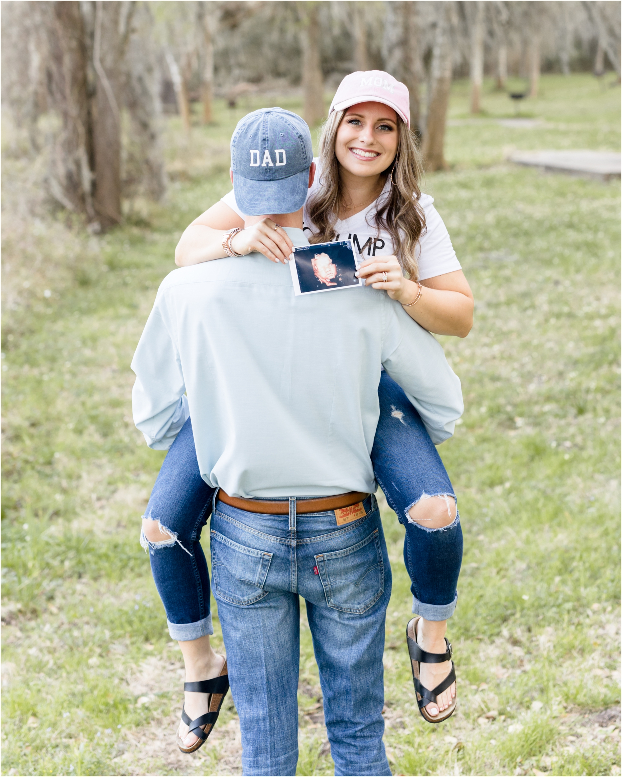 Sweet pregnancy announcement with Mom and Dad baseball caps. Photo by Lifetime of Clicks Photography.