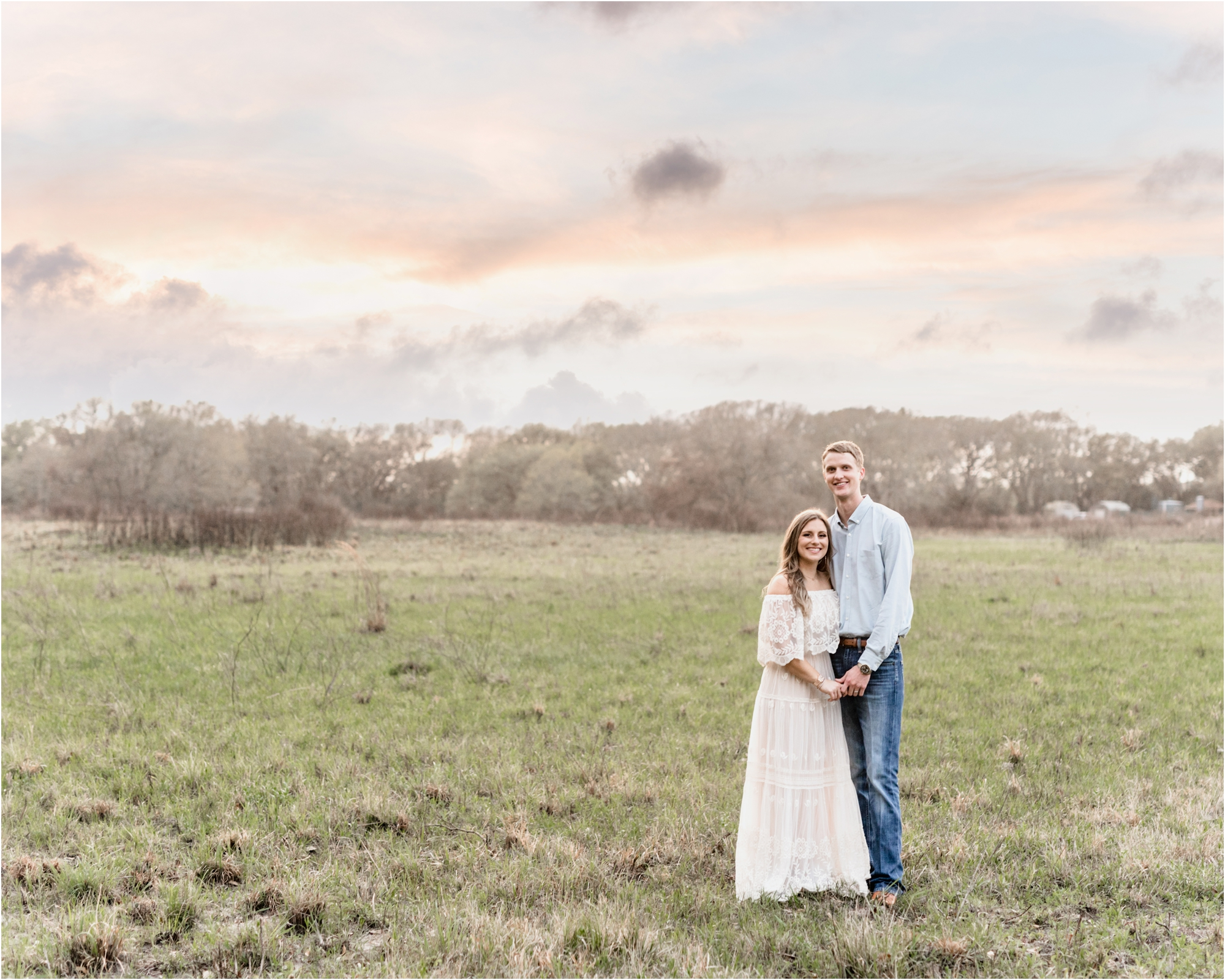 Couple holding hands under cotton candy skies in Houston Texas. Photo by Lifetime of Clicks Photography.
