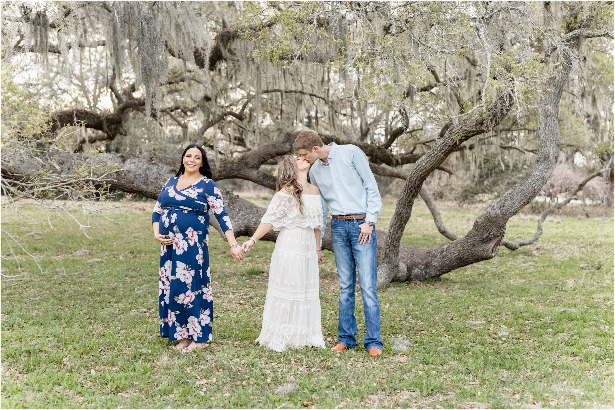 Surrogate maternity session with surrogate Mother and parents under weeping tree in Houston, TX area. Photo by Kelly of Lifetime of Clicks Photography.