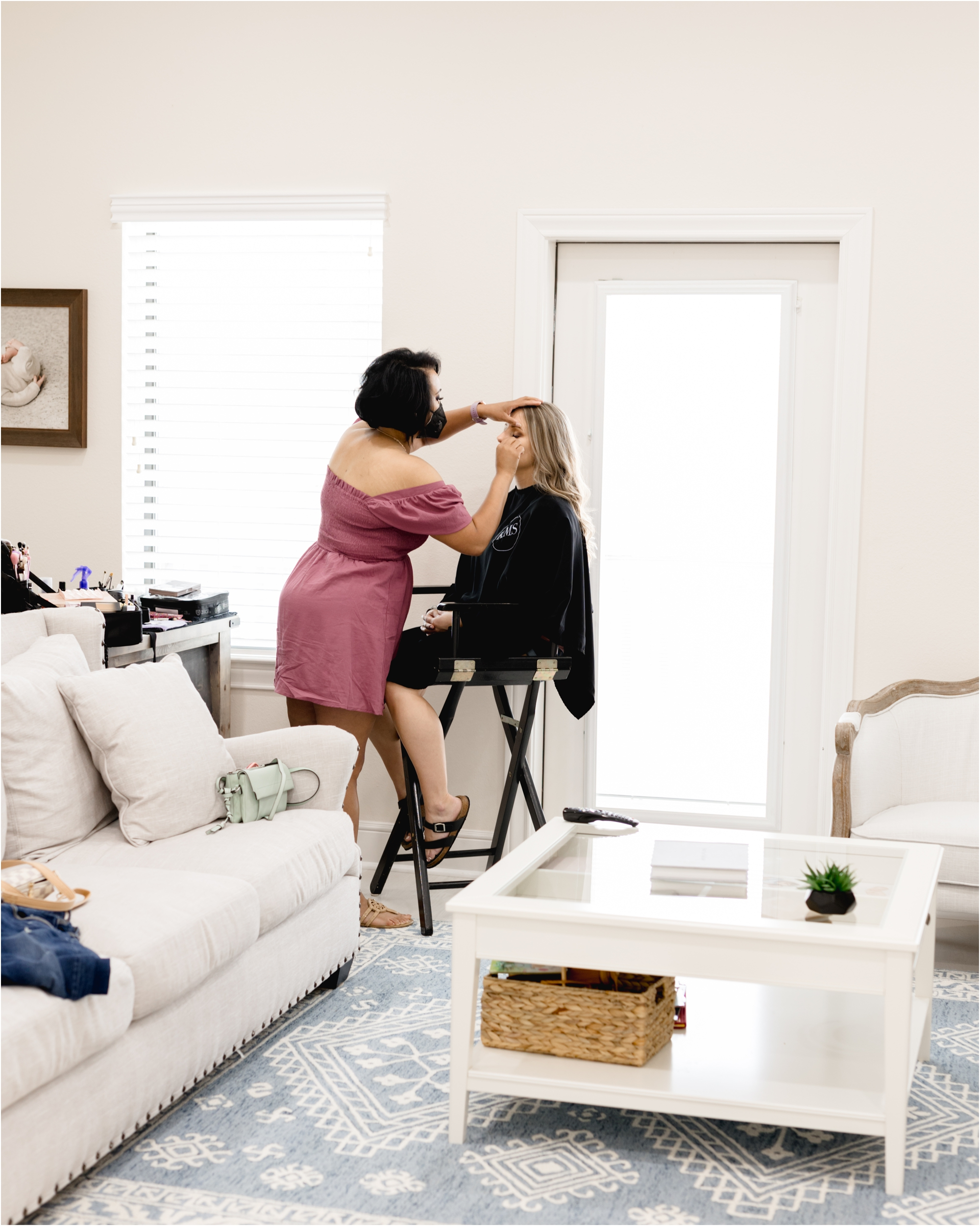 Hair and makeup application prior to surrogate maternity session in Houston with Kelly of Lifetime of Clicks Photography.