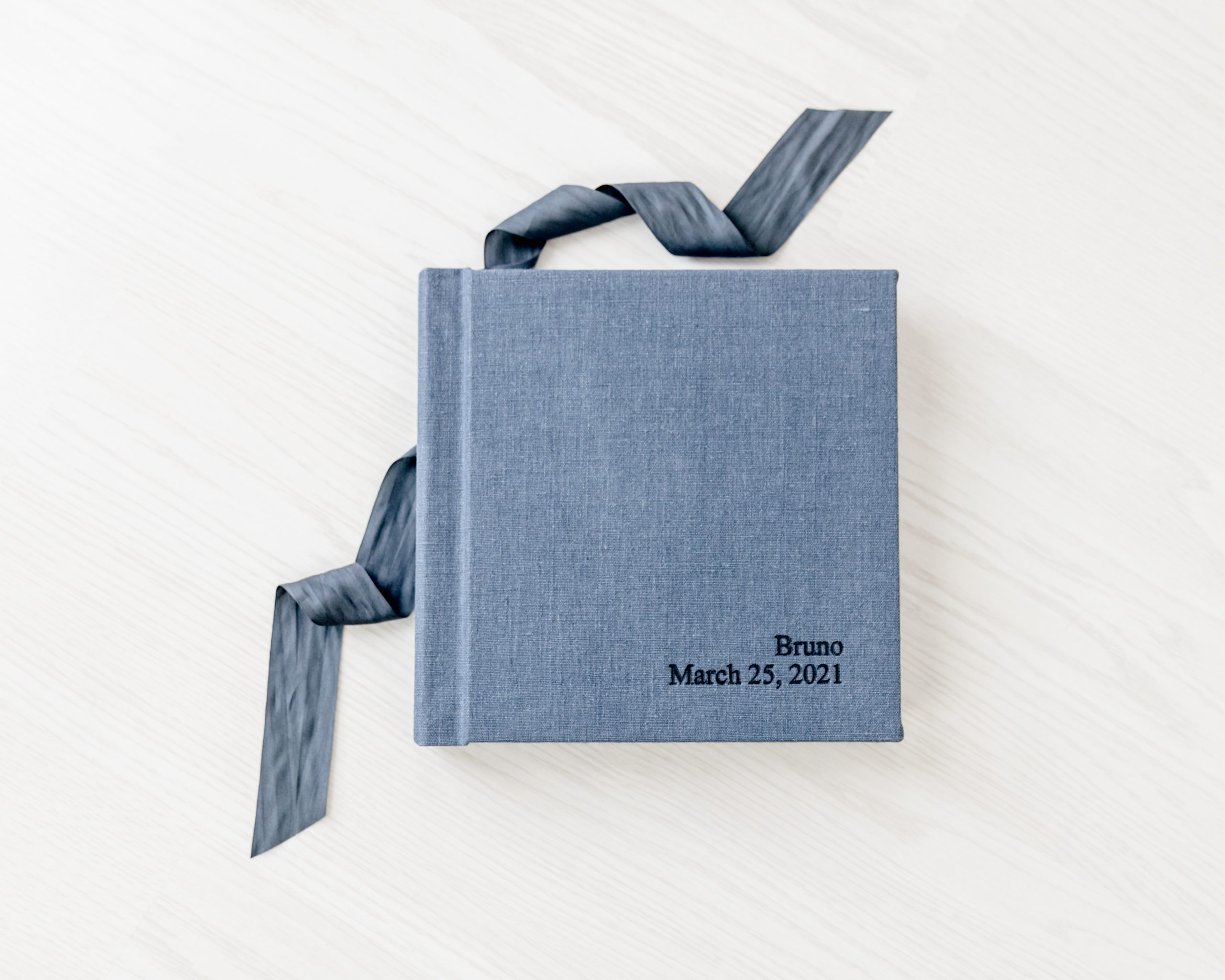 Cover of blue linen heirloom album designed by Kelly from Lifetime of Clicks Photography.