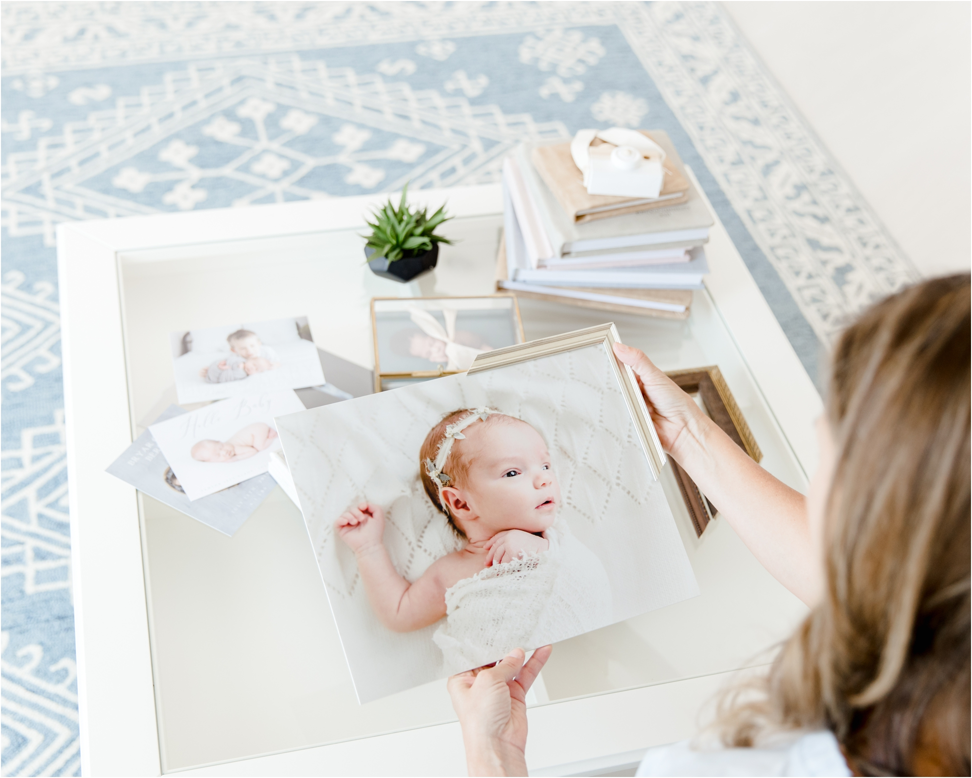 Closeup of framing options with print of baby. Photo by Houston newborn photographer, Lifetime of Clicks Photography.
