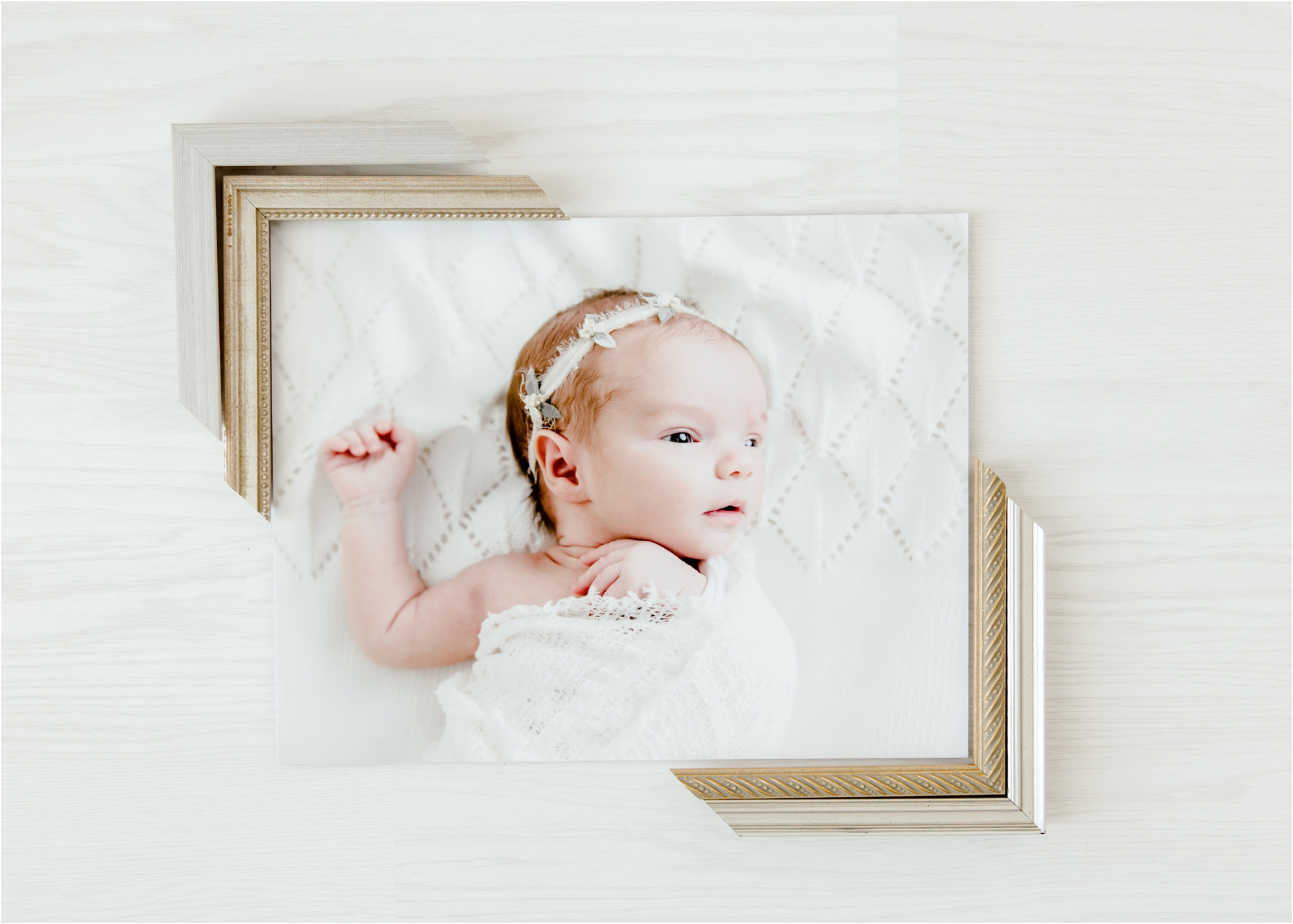 Flat lay of newborn image with frame corners. Photo by Lifetime of Clicks Photography.