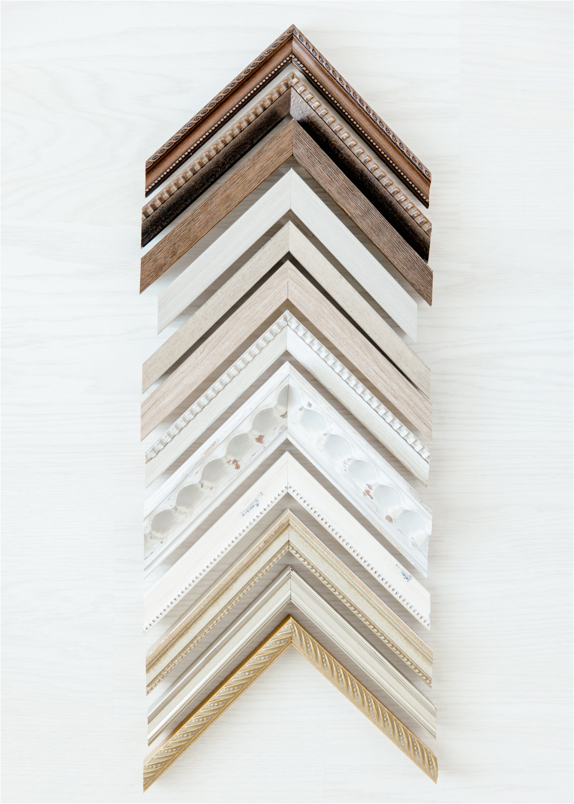 Frame corners from simple, modern designs to ornate silver tones and rustic wood options. Options provided by full service Katy TX photographer, Lifetime of Clicks Photography.